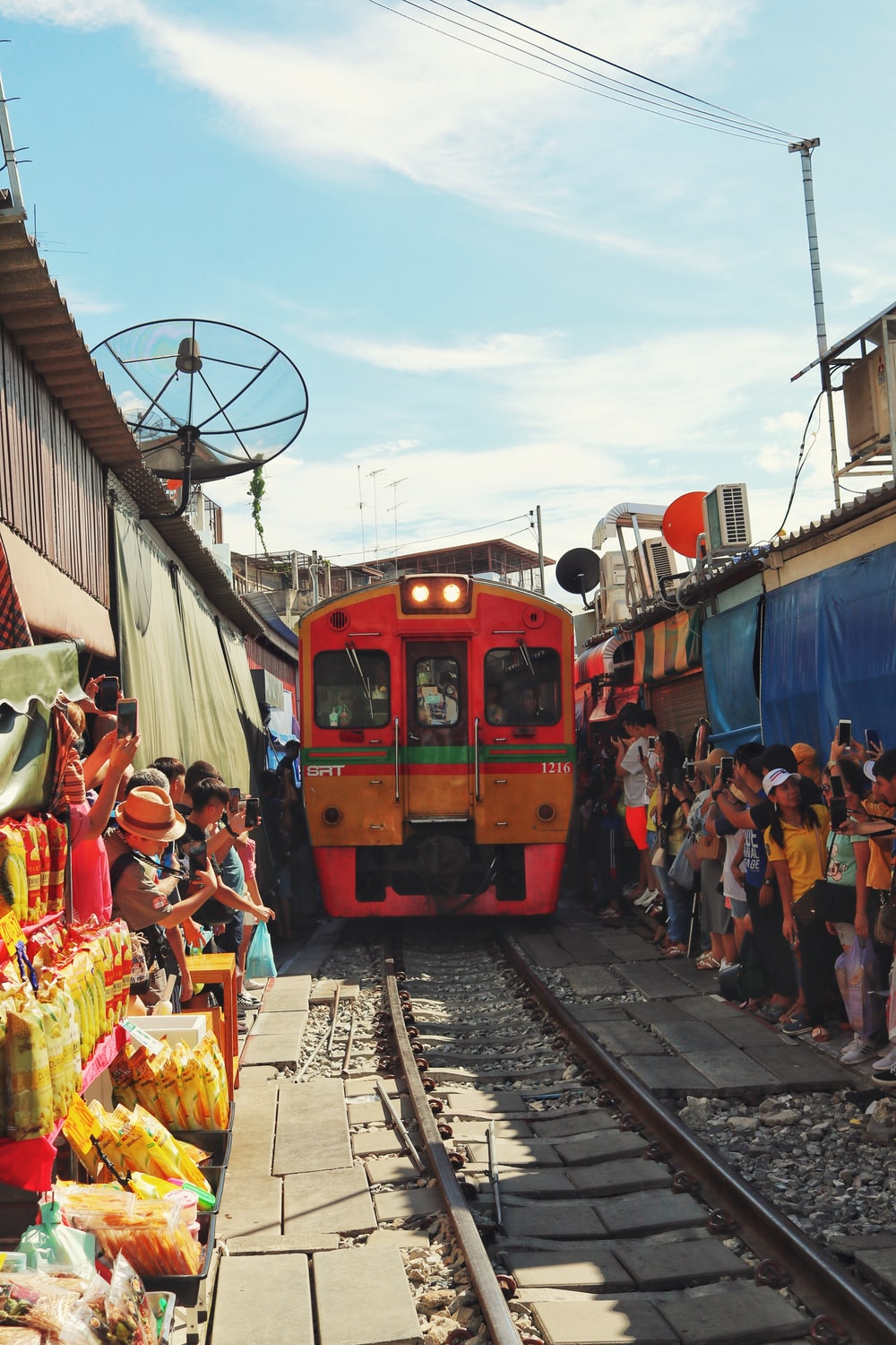 people near red train during daytime