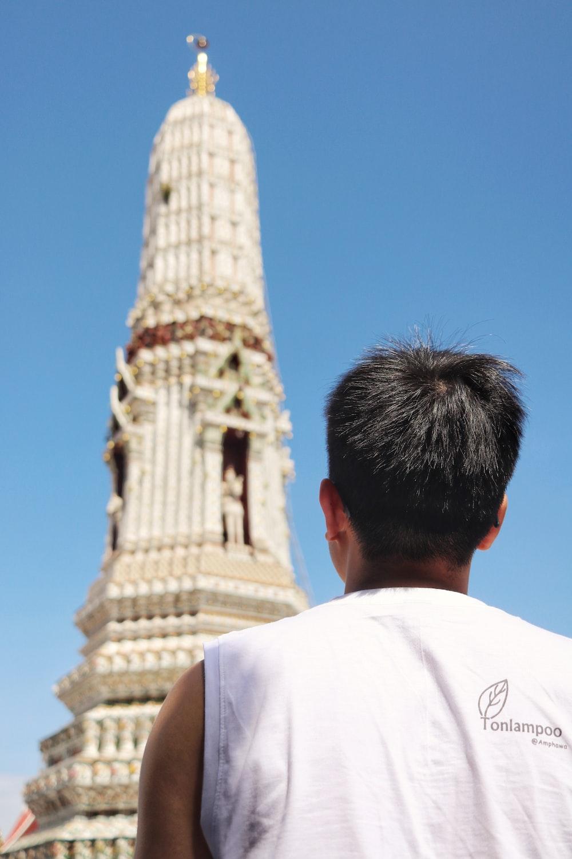man facing tower during day