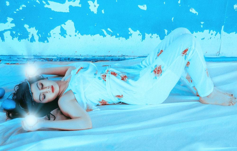 woman lying on bedspread