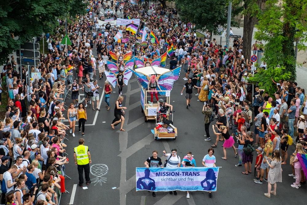 people in parade during daytime