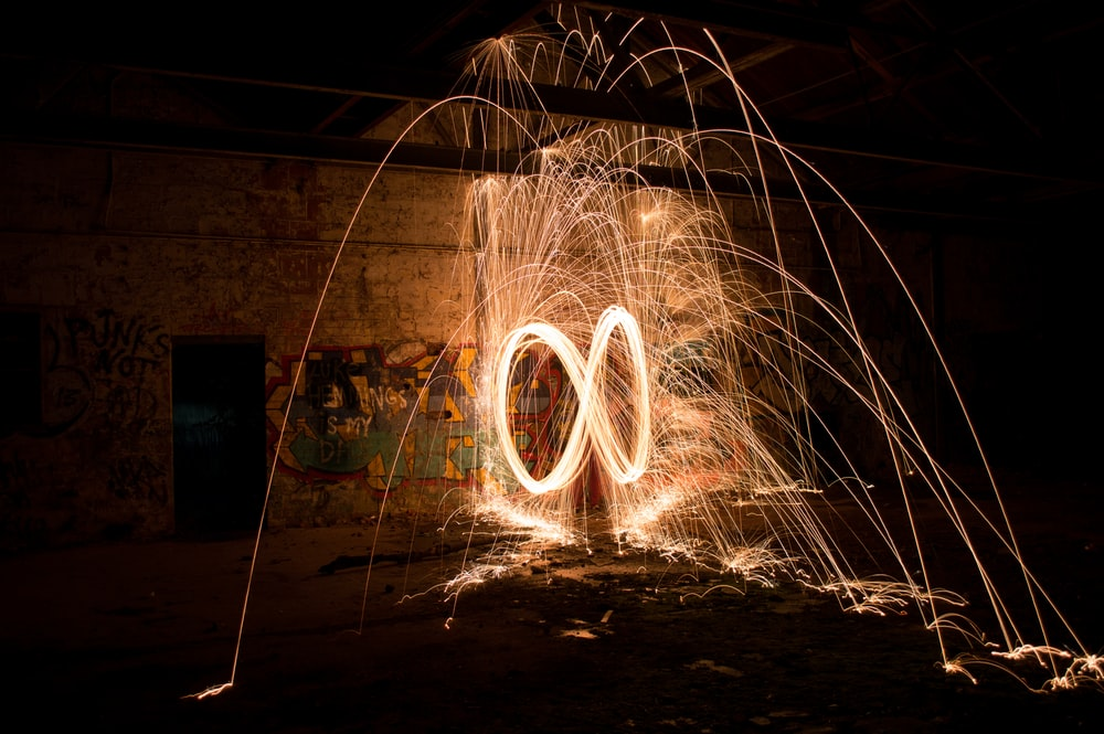 steel wool photography of during nighttime