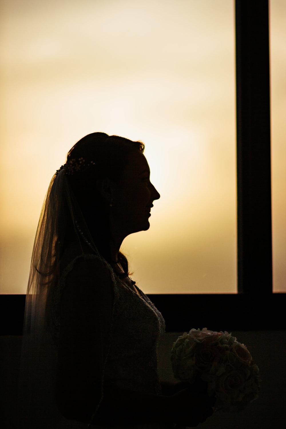 silhouette of woman holding flowers