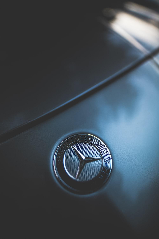 closeup photo of Mercedes-Benz emblem