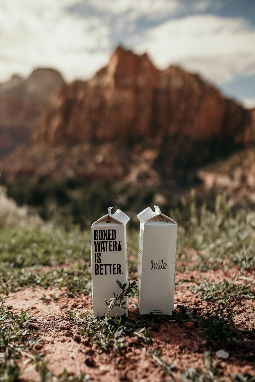 2 white water box across brown mountain