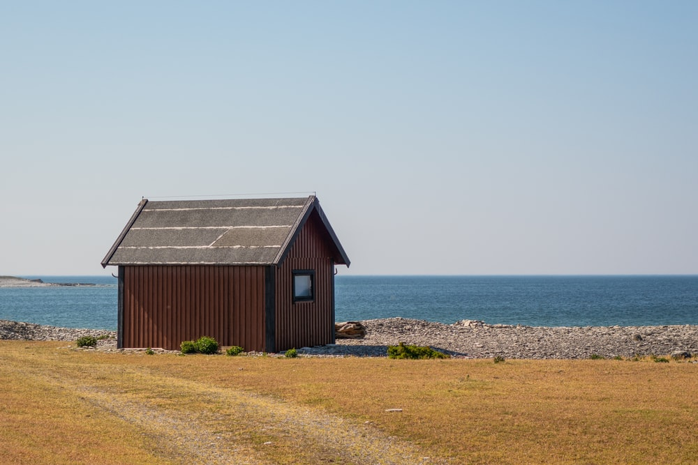 brown house near shore