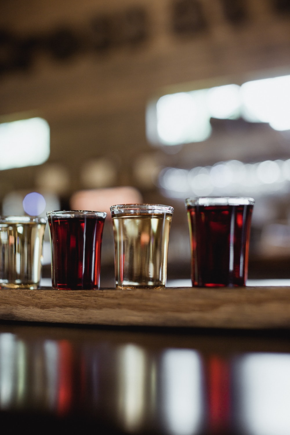 four clear shot glasses