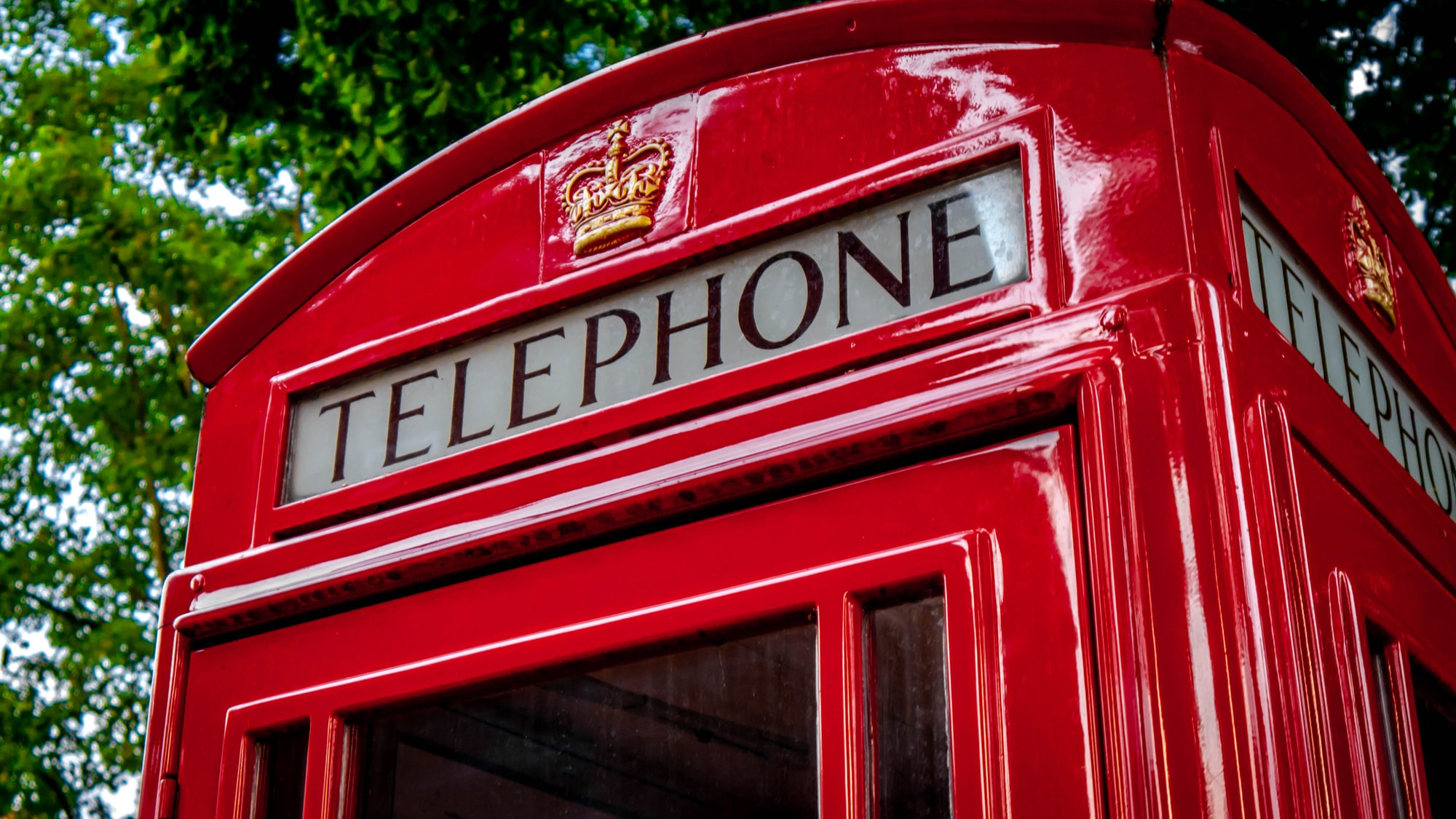 A classic, red London telephone booth