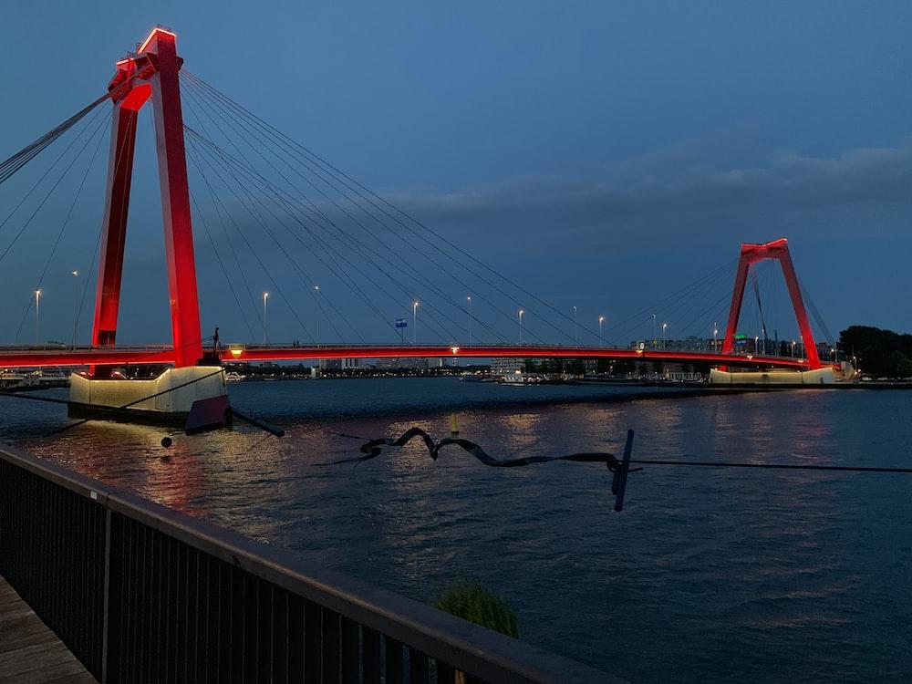 red concrete bridge at night time view