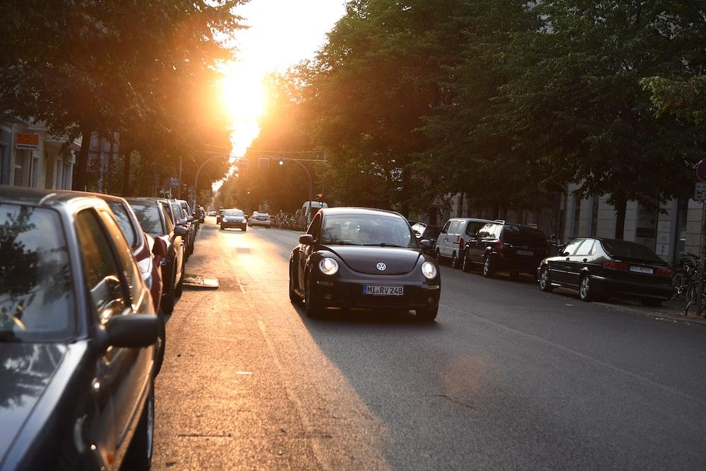 black Volkswagen New Beetle on road