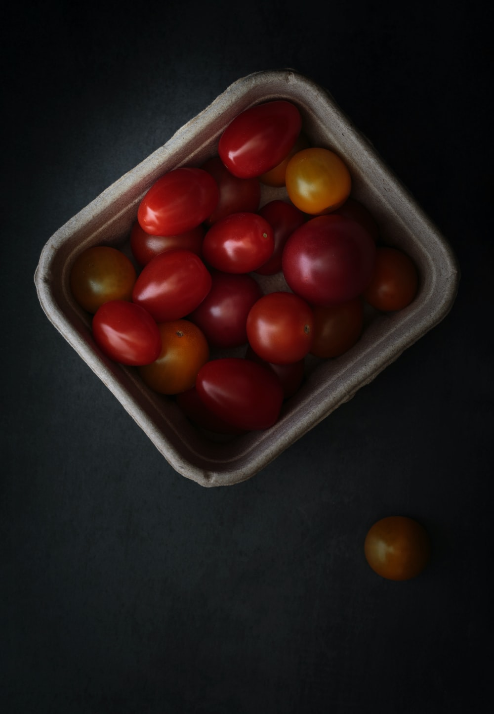 round red fruits on white plastic container