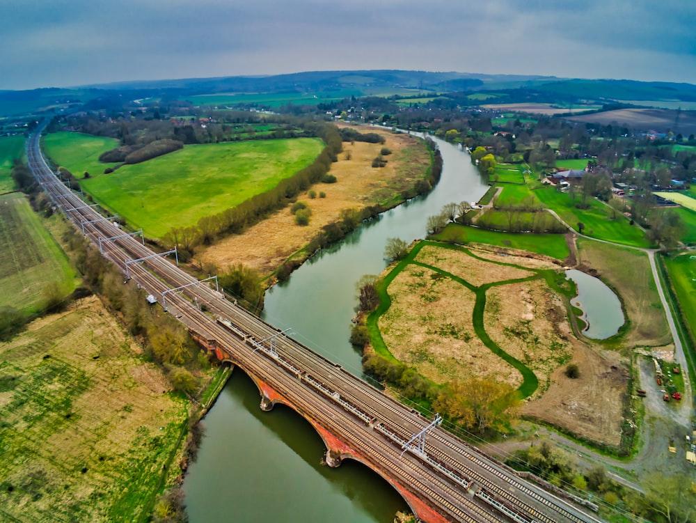 bridge over the river under grey cloudy sky