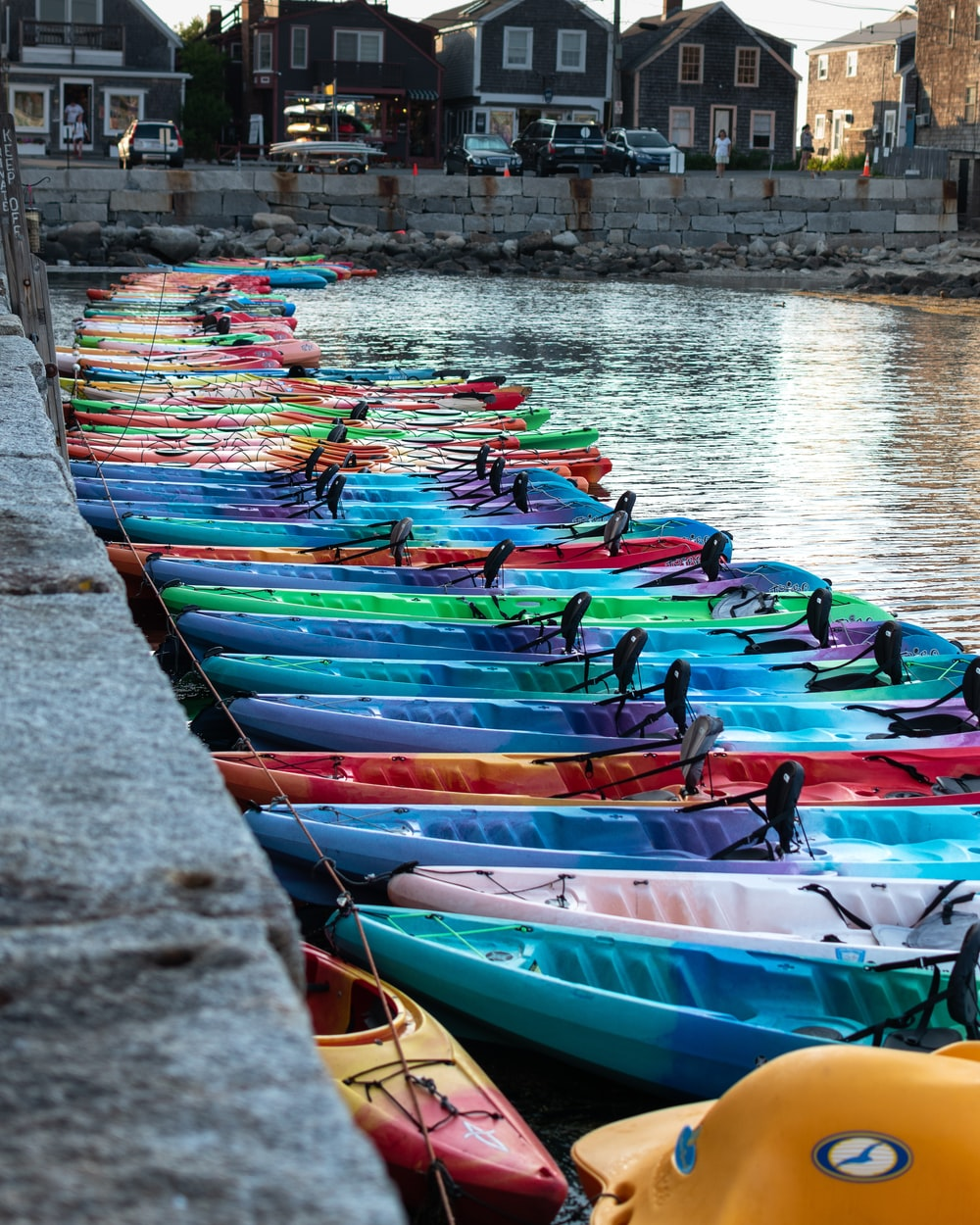 assorted-color plastic kayaks on sea