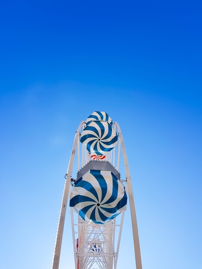 low angle photo of blue and white ferries wheel