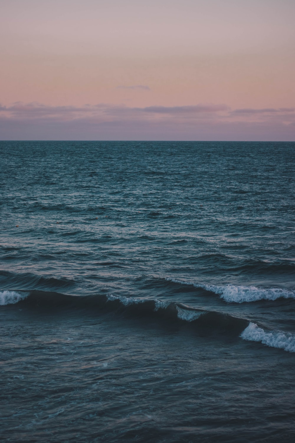 grey and pink sunset sky over the sea