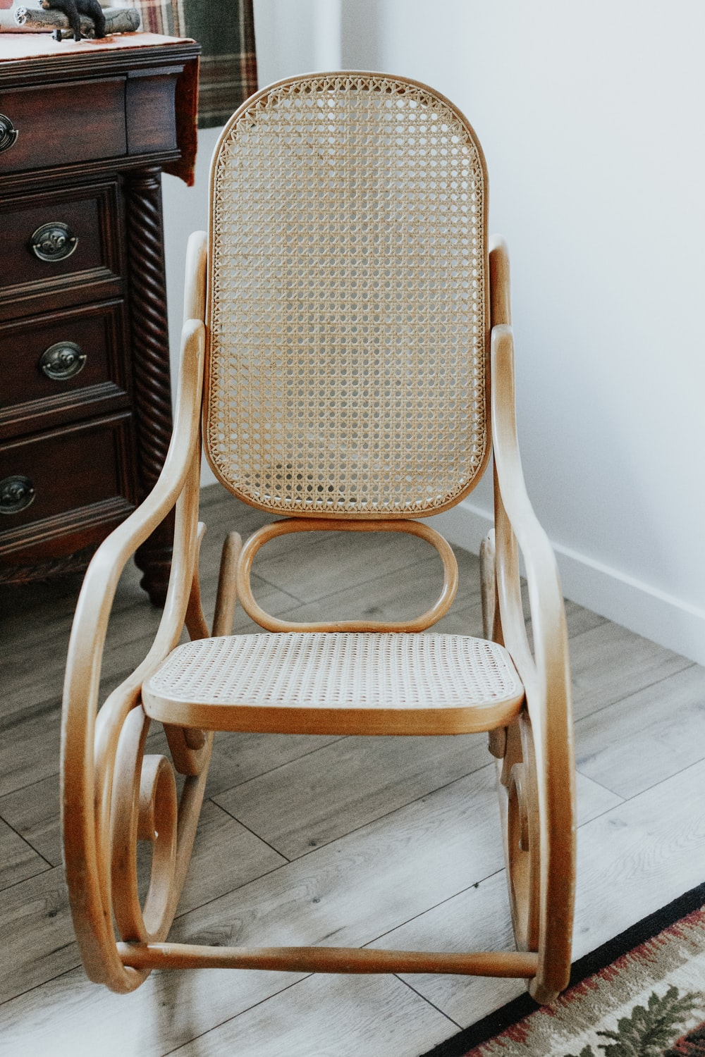 brown wooden rocking armchair