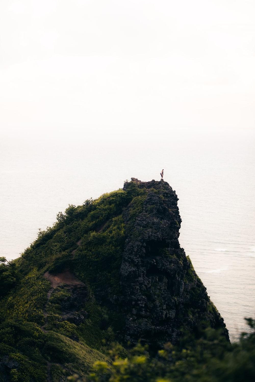 sea beside mountain