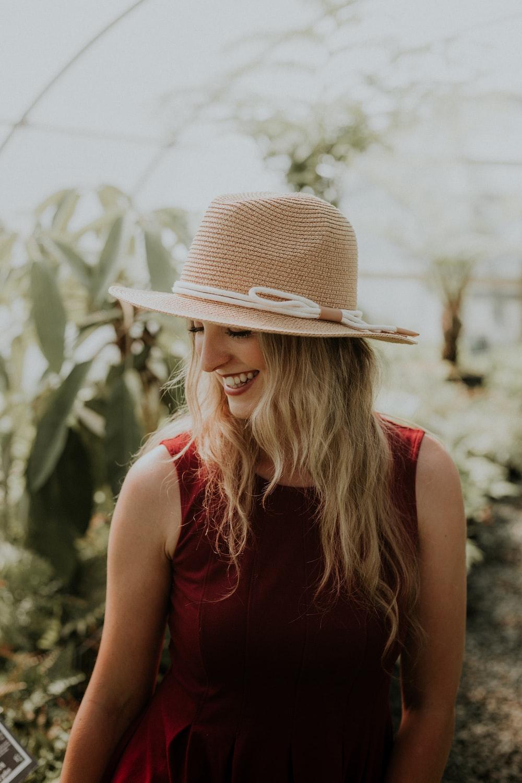 smiling woman wearing red sleeveless dress