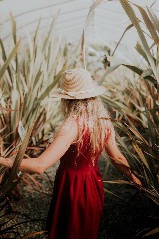 woman standing beside plants