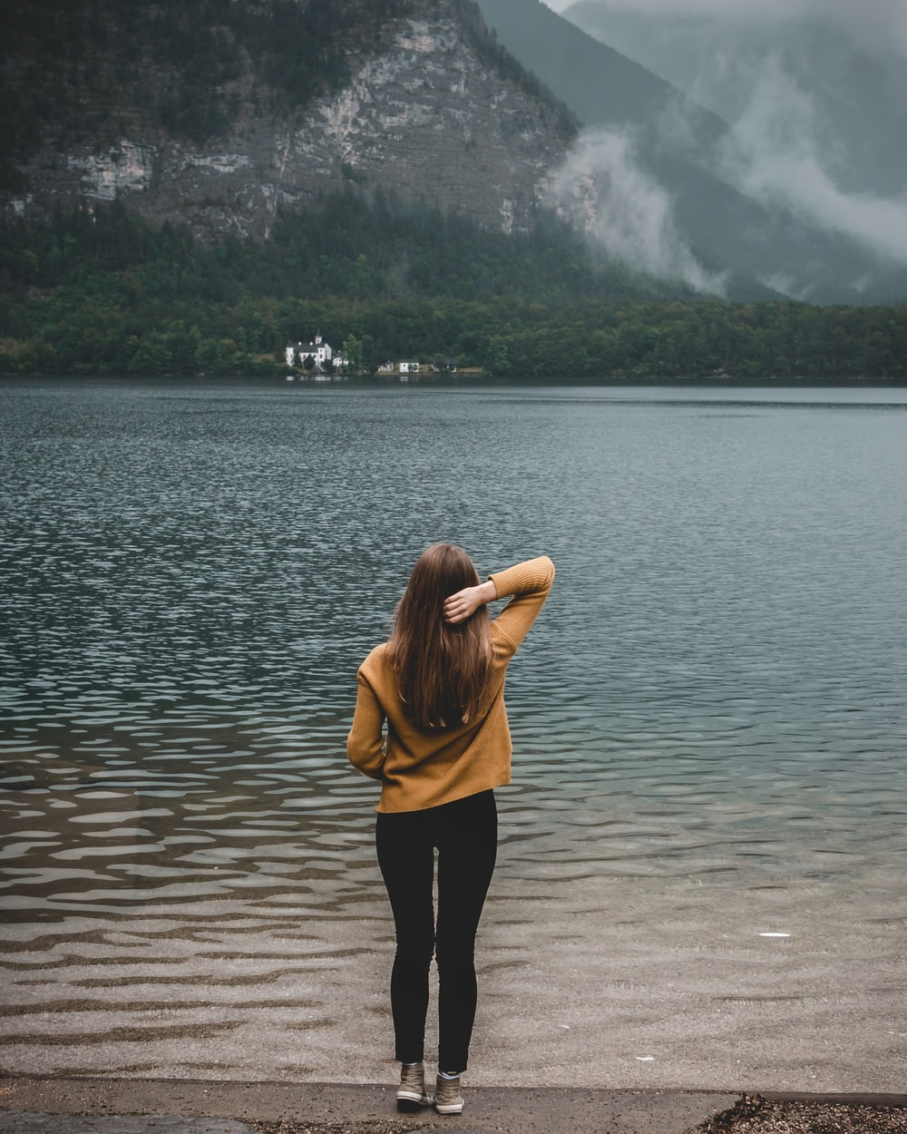 woman standing on shore during daytime