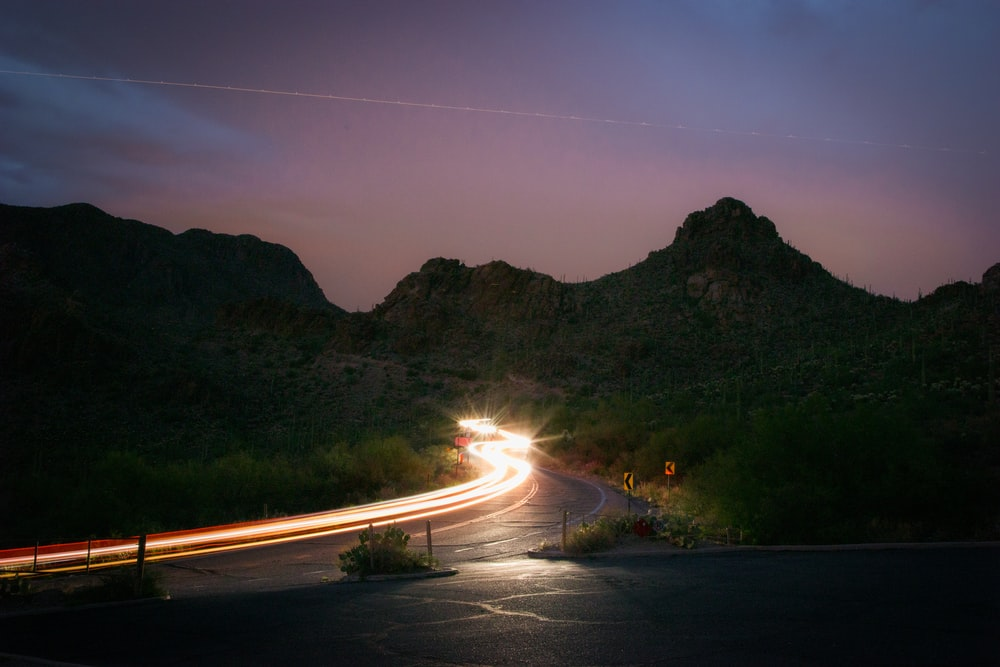 time-lapse photography of vehicle near mountains