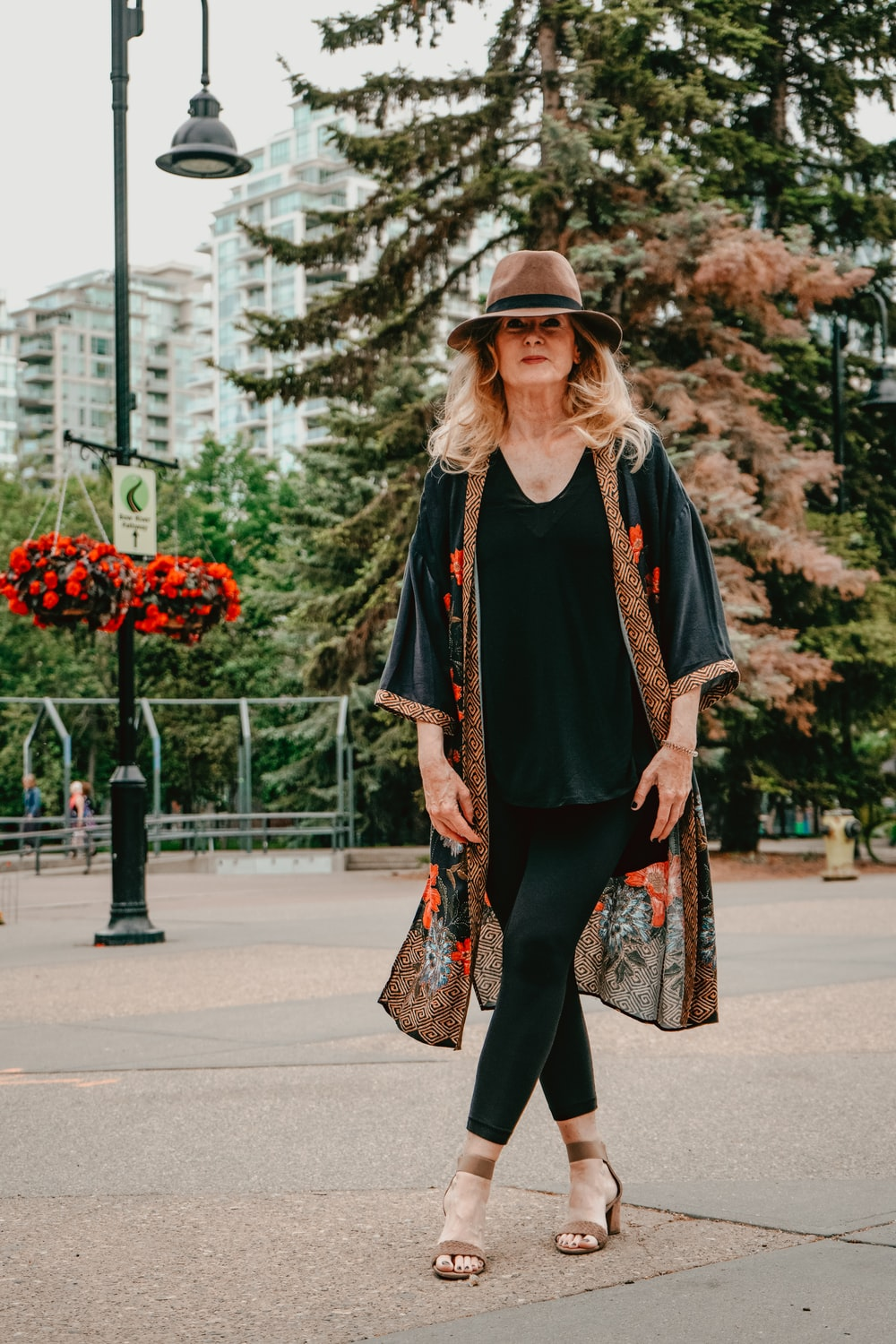 woman wearing black and brown floral cardigan