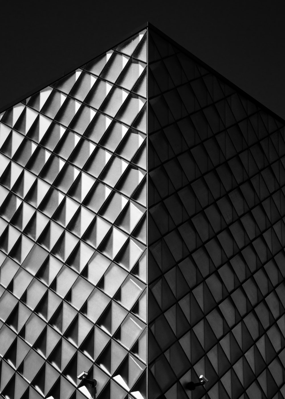 grayscale photo of pyramid building