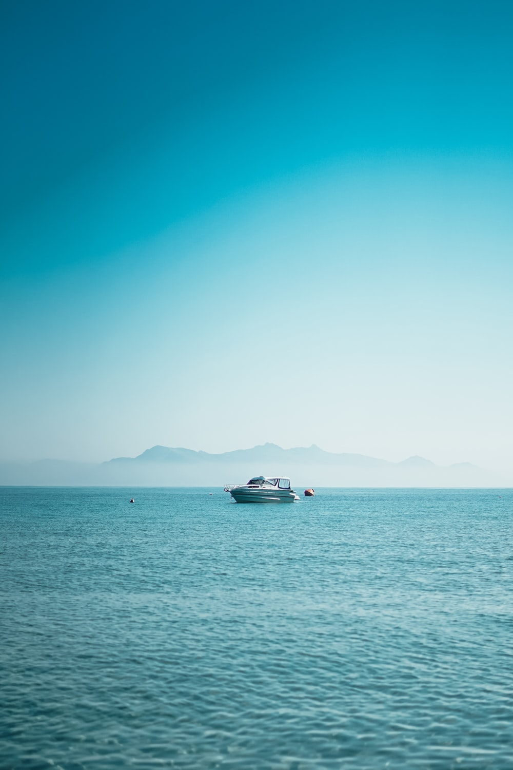 boat at the sea during daytime