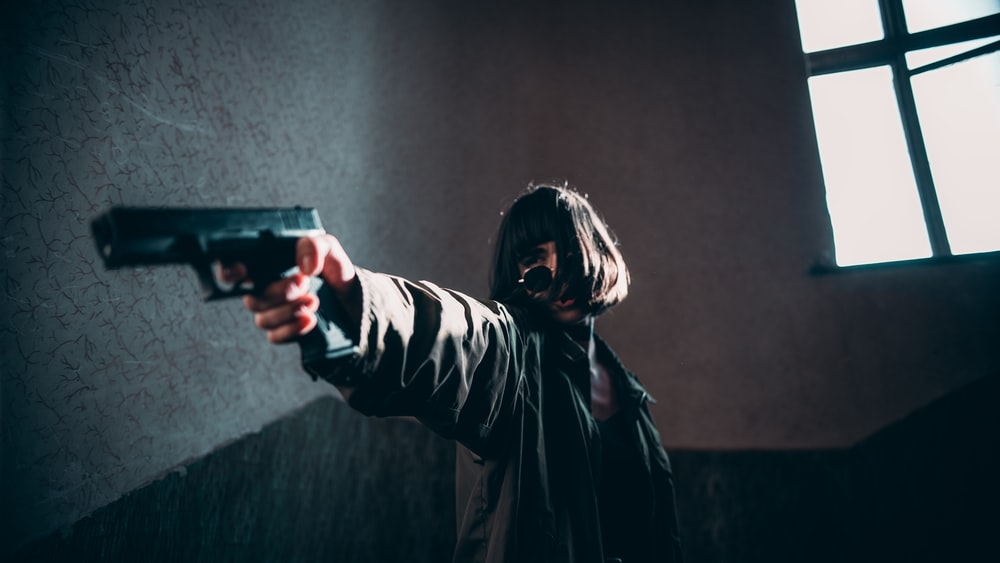 woman pointing hand gun