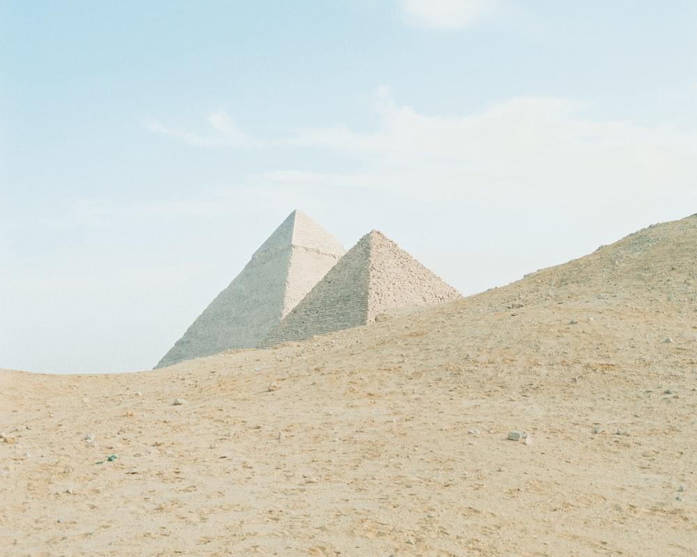 pyramids under blue sky