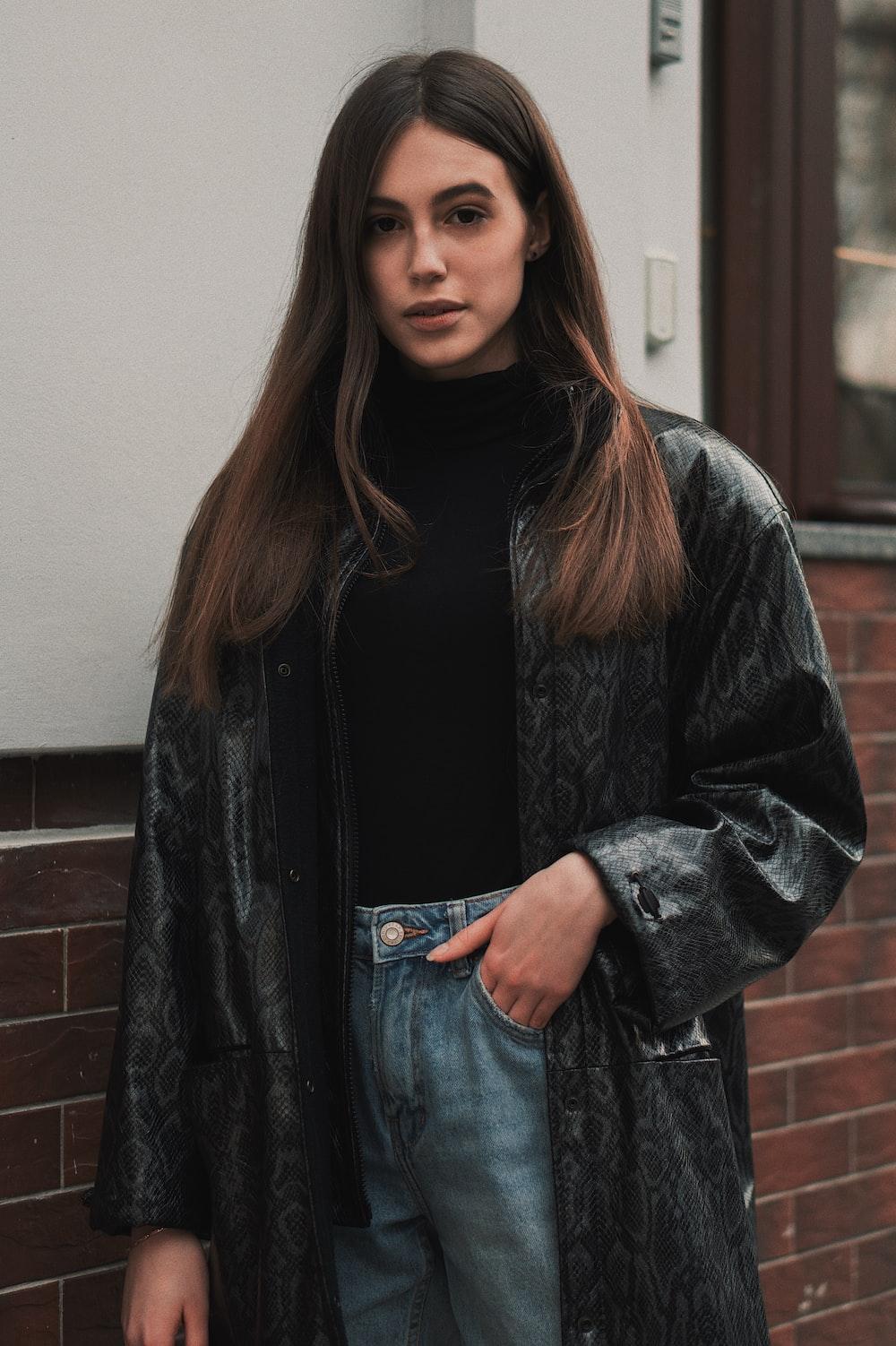 woman wearing black floral coat