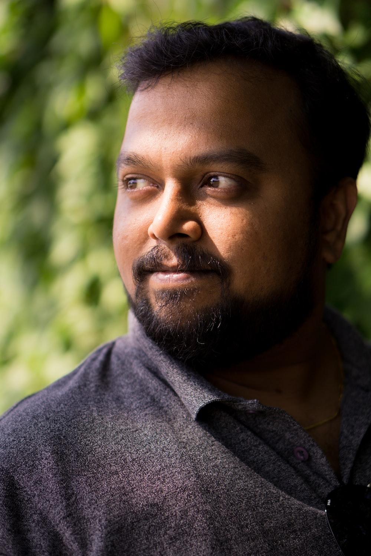 man wearing black polo shirt outdoor during daytime