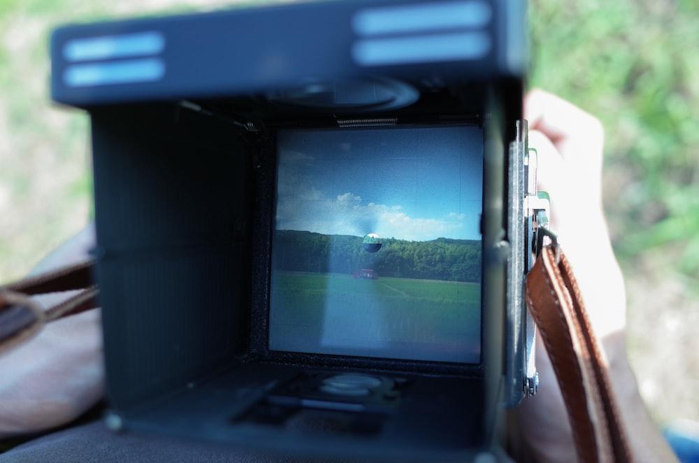 shallow focus photo of black camera