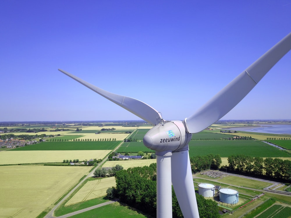 architectural photography of white 3-blade wind mill