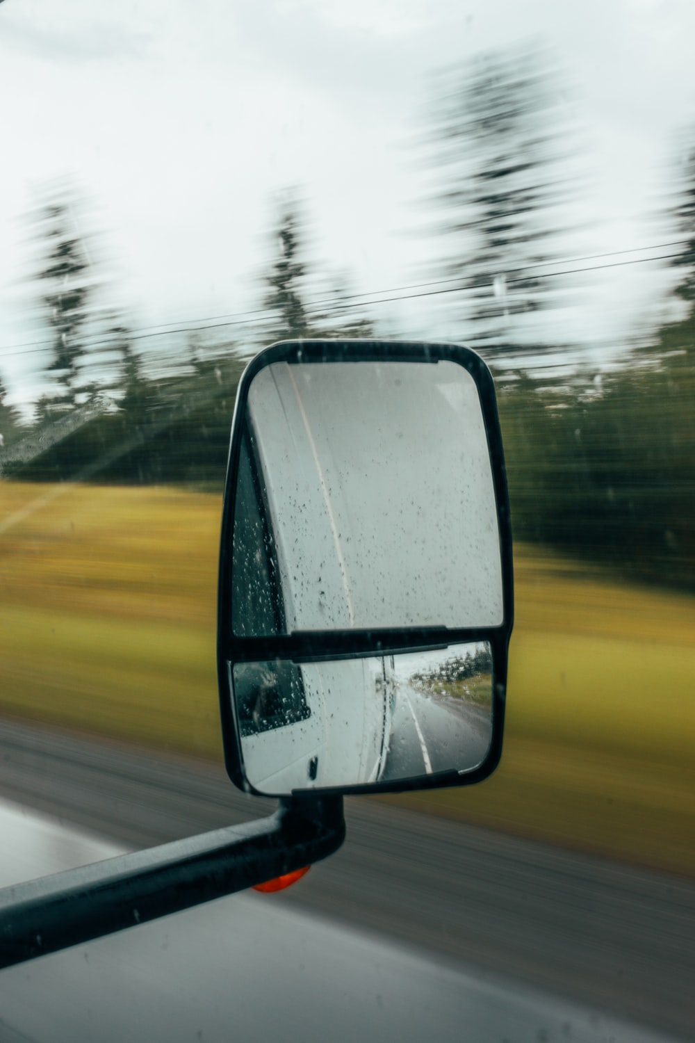 shallow focus photography of vehicle wing mirror