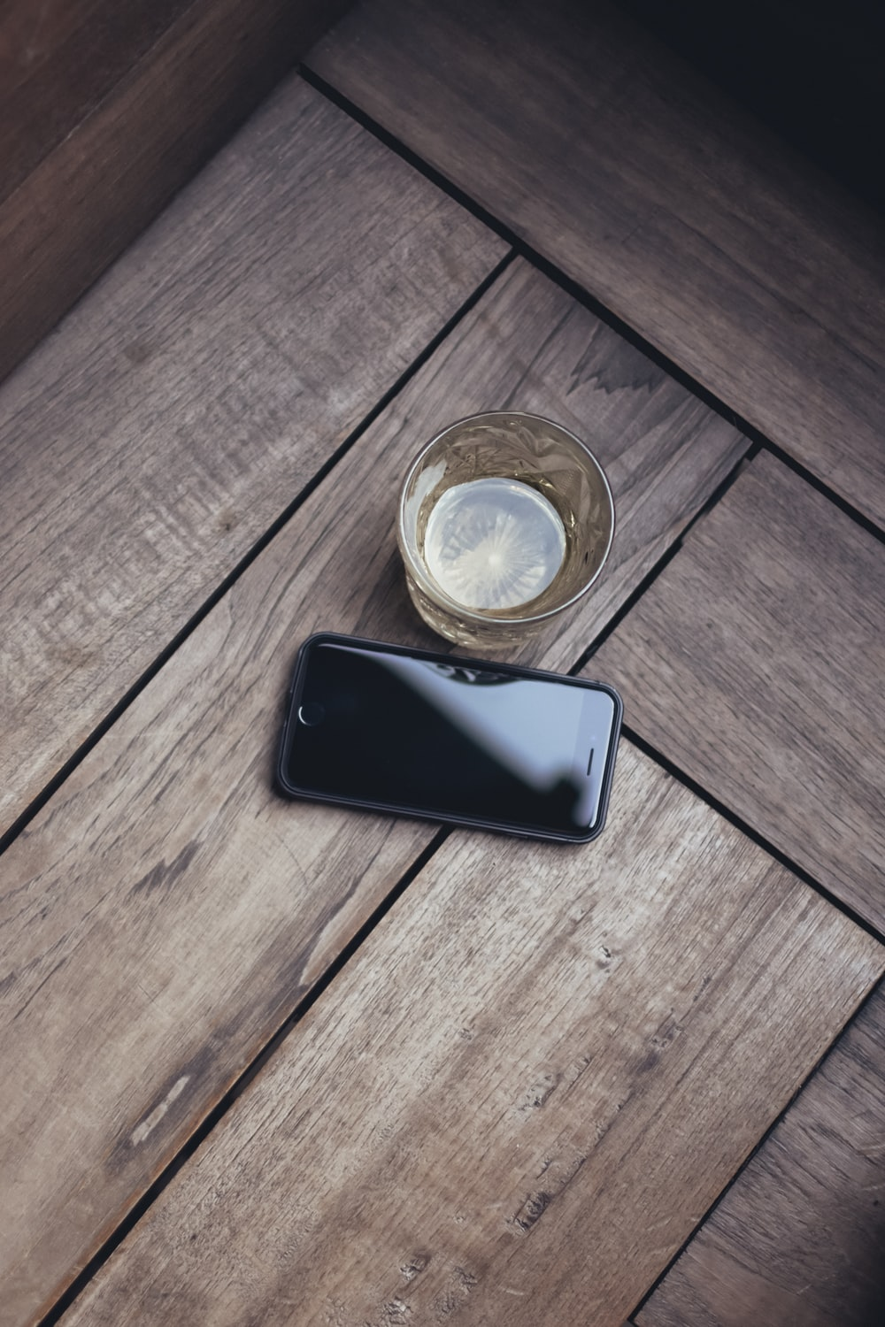 black Android smartphone near glass