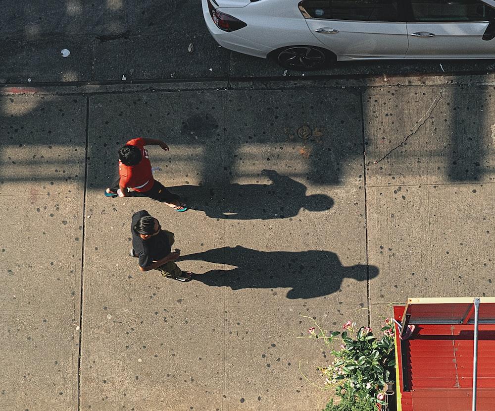 two people walking near vehicle park