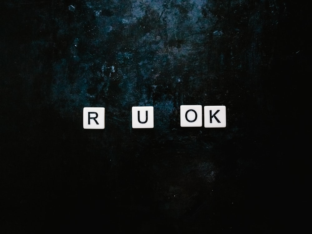 R U OK letters with black background