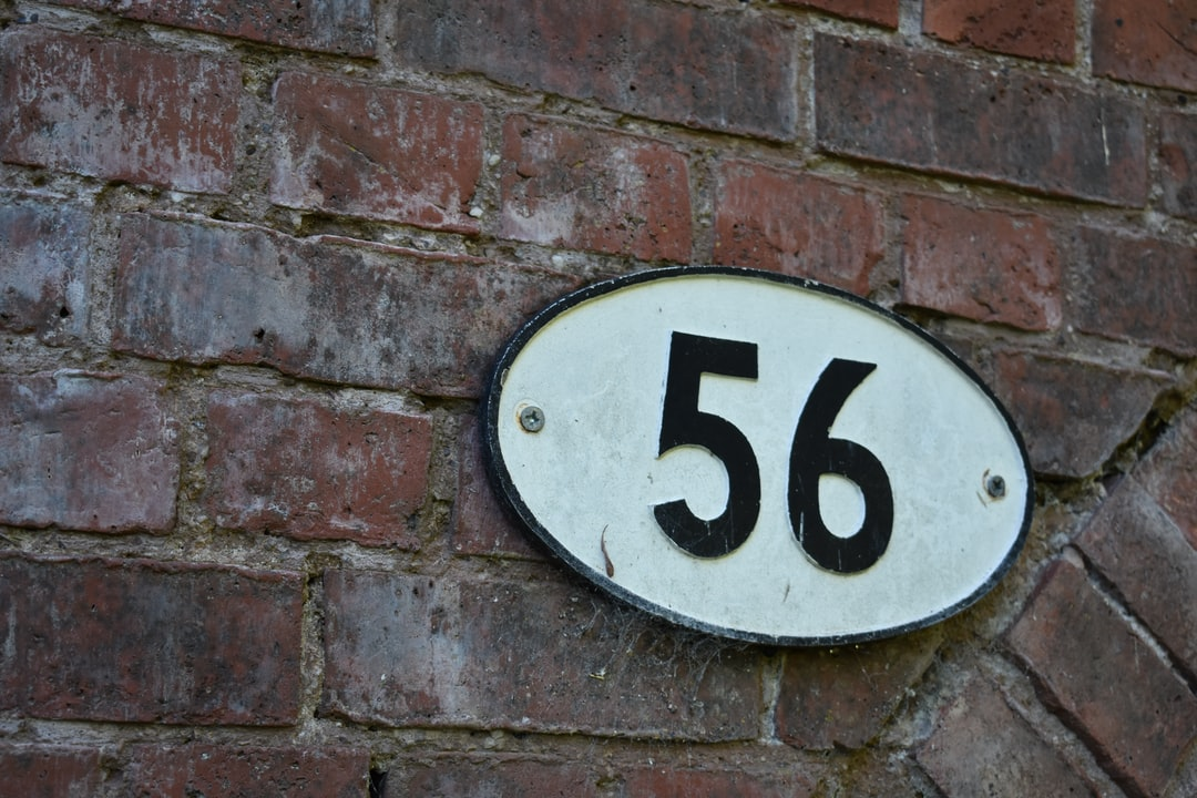 Black and white oval bridge number 56 sign on the Stratford upon Avon canal.
