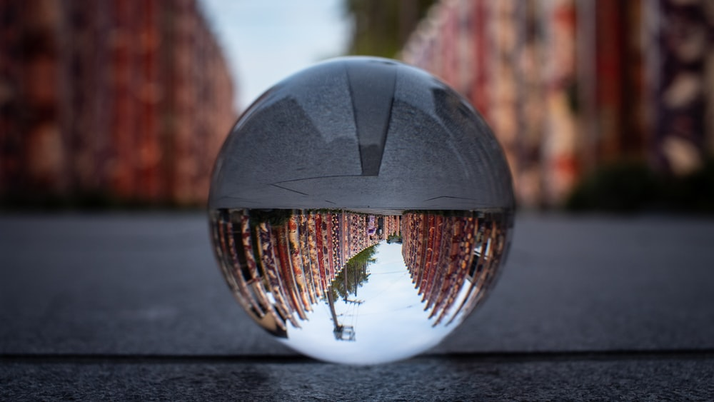 crystal ball photography of building during daytime
