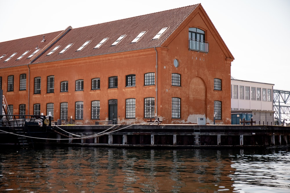 brown building near water during daytime