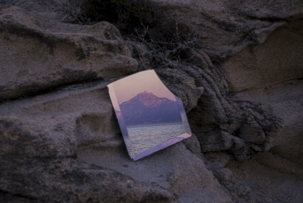mirror leaning on rock