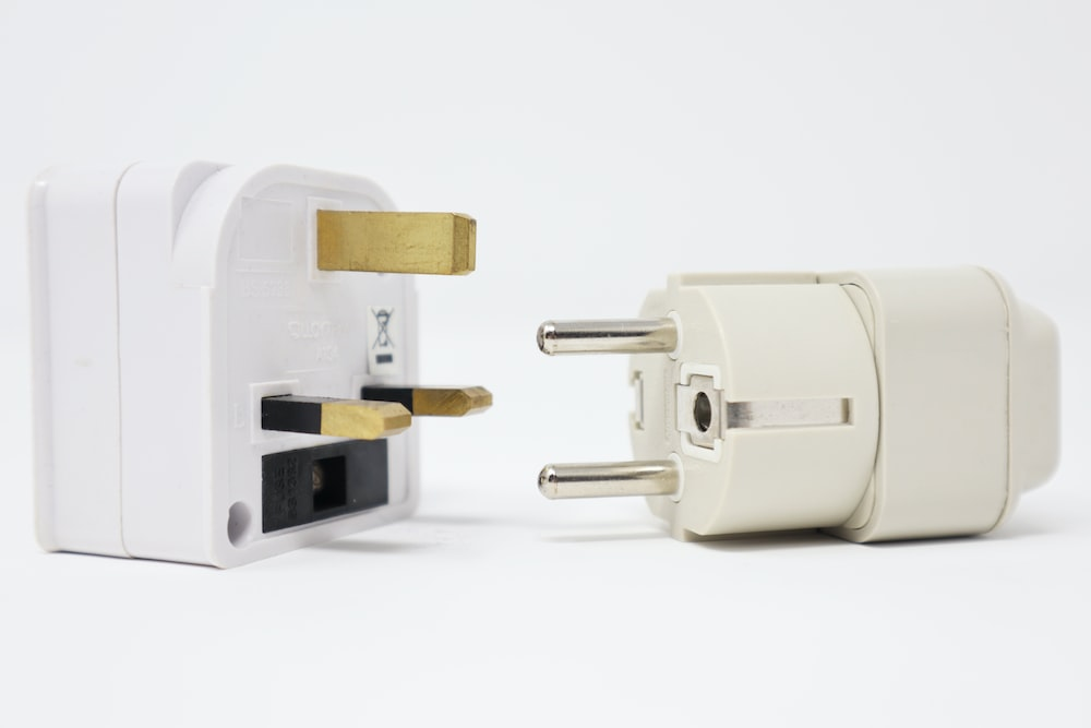 two white power adapters on white background