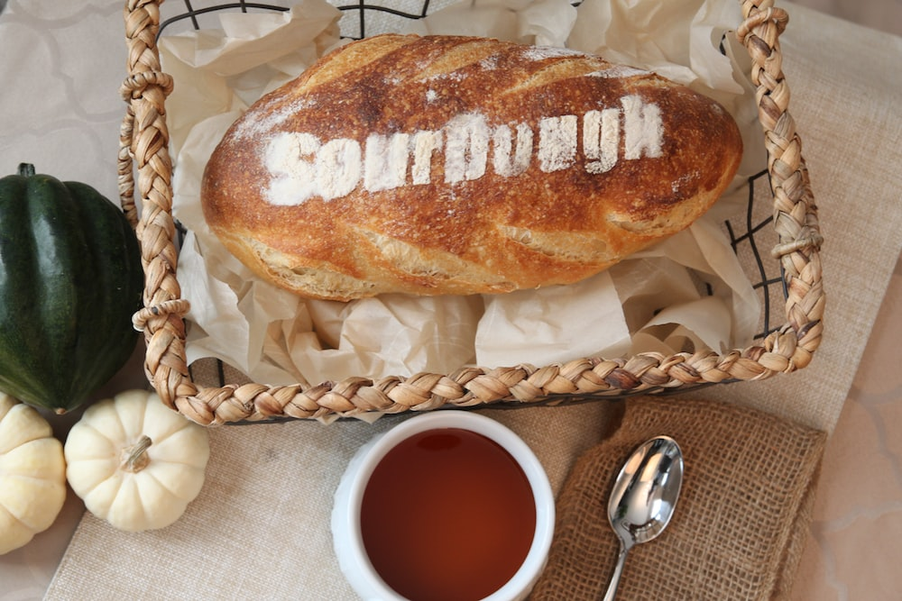 pastry bread beside red sauce