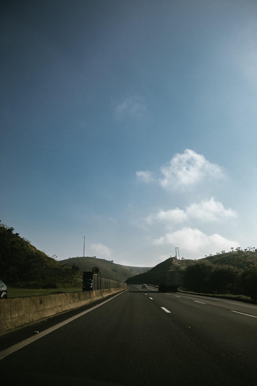 asphalt road under blue sky