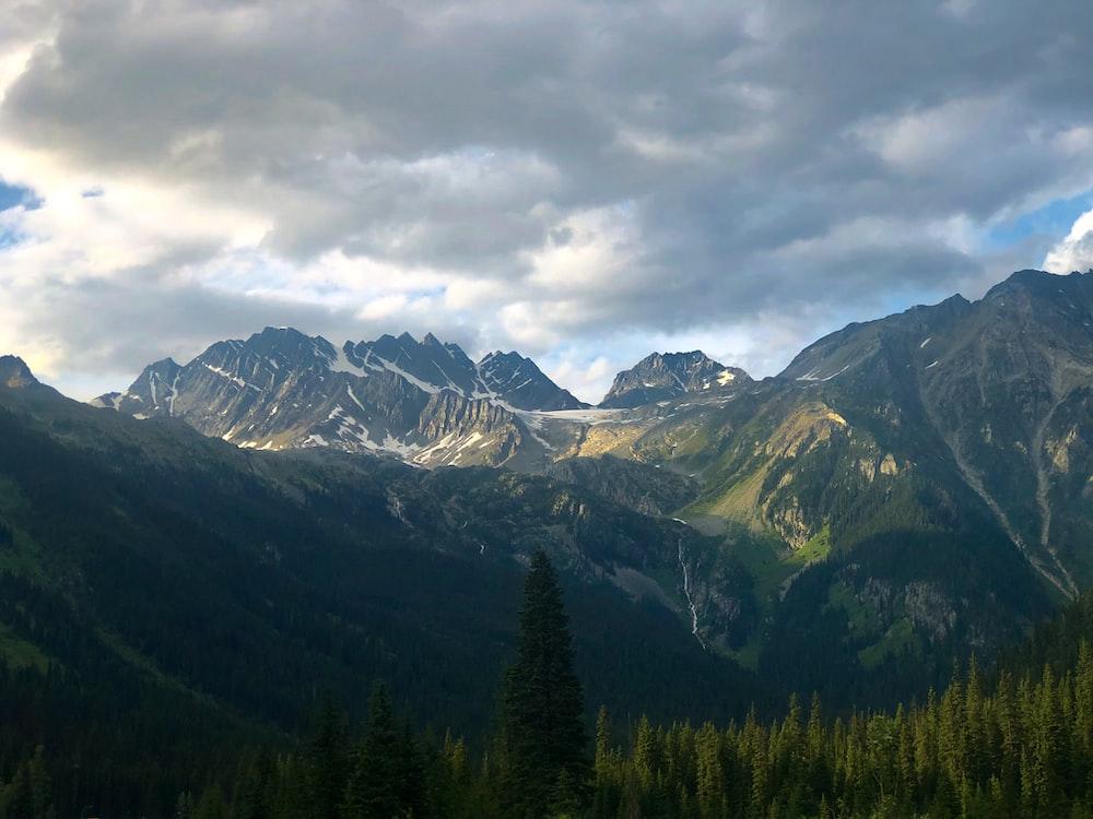 mountain range under nimbus cloud s