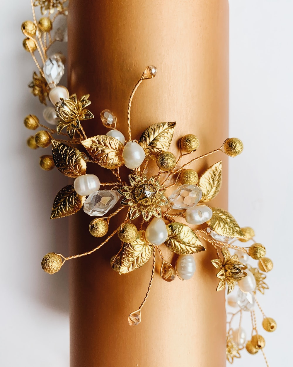 gold-colored white pearl floral accessory