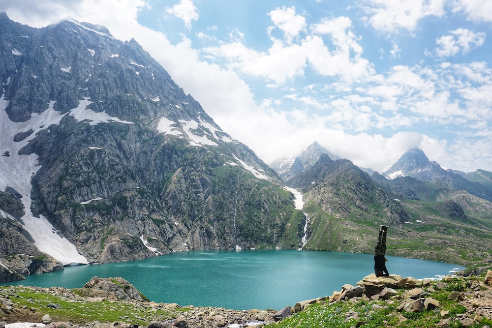 photography of lake beside mountain during daytime