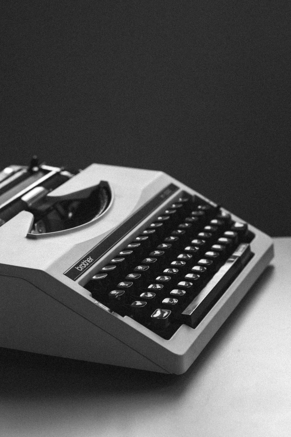 white and black typewriter close-up photography