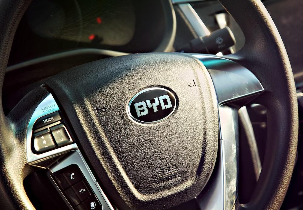black vehicle steering wheel close-up photography