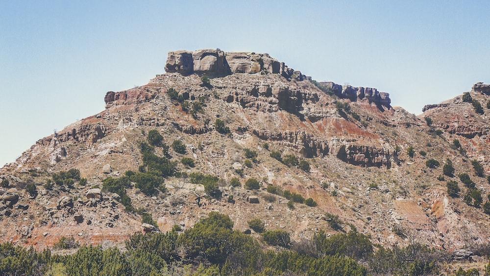 dry terrain mountain under clear sky
